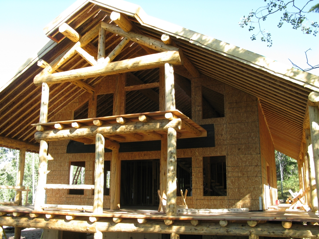 Log cabin construction costs log cabin home construction for Home construction estimator