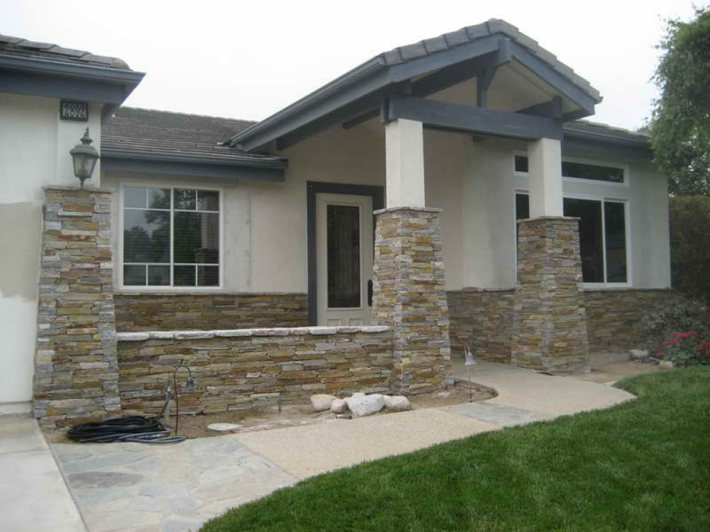 Stone veneer house colonial house stone veneer planning for Stone veneer house pictures