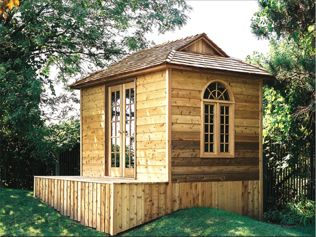 Tiny houses log cabin one levels tiny house log cabin kits for Small backyard cabin