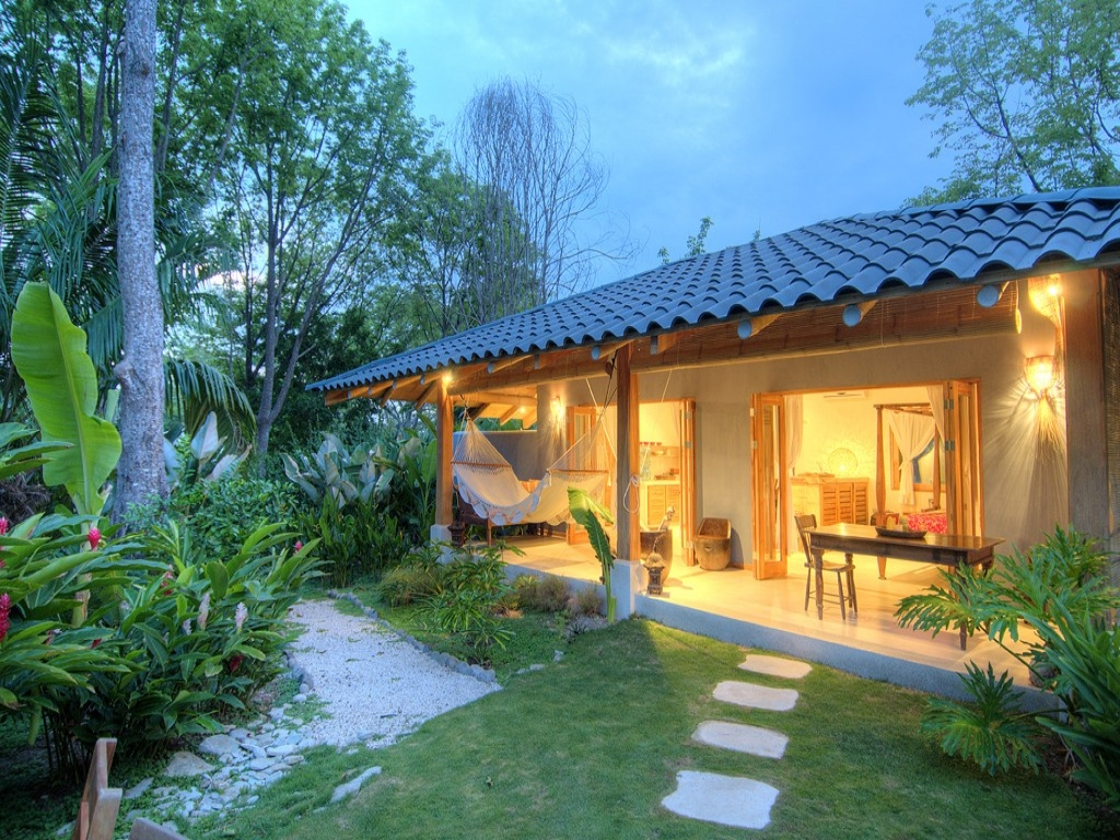 Tropical beach terrace tropical beach small bungalow house for Luxury bungalow designs