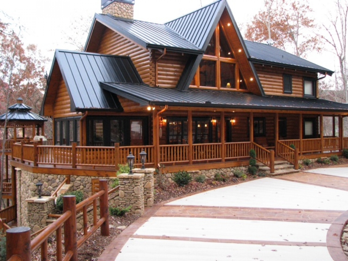 Two story log cabin two story log homes with wrap around for Three story log cabin