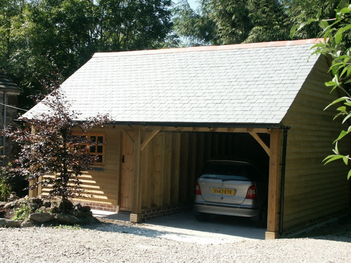 Log cabin garage kits http wwwbungalowrenovationscom for Log cabin style garages