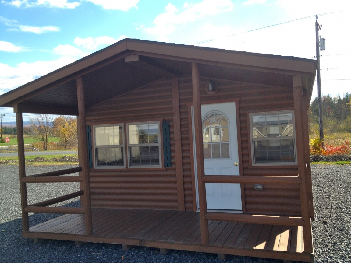 Compact cabins small scale wood cabins wood cabin homes for Compact cottages