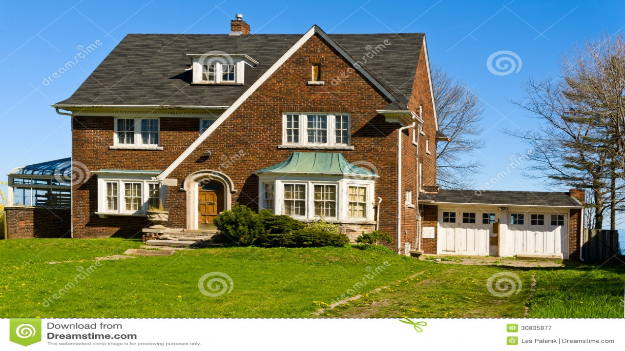 Beautiful two story with balcony two story brick houses 2 for Pretty two story houses