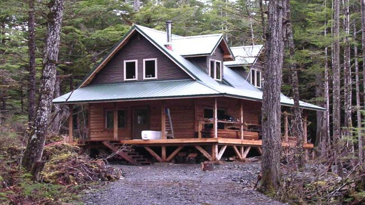 A Rustic Log Cabins On Stream Two Story Rustic Cabin Plans