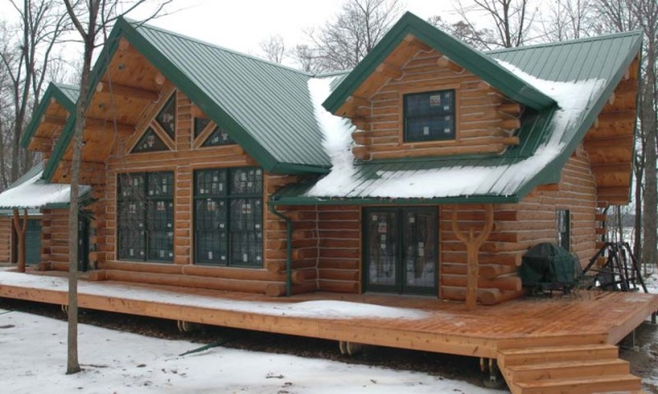 Log cabin modular homes log cabin home with metal roof for Metal cabins homes