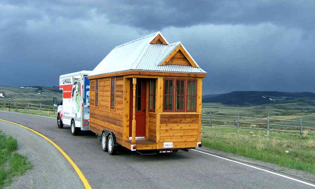 The 130 square foot fencl tiny house being pulled by a for Tiny house estimator