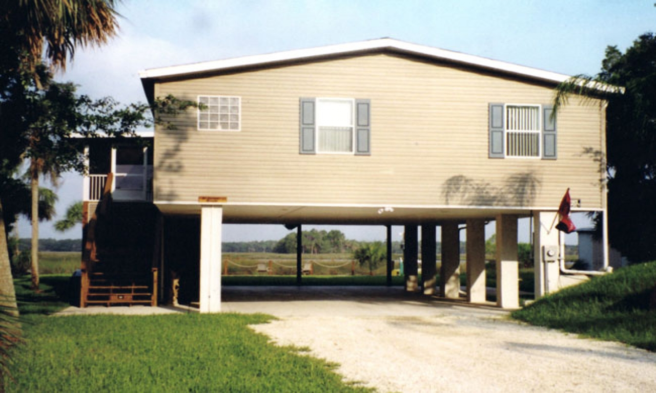 Homes on stilts house plans modern stilt house stilt home for Stilt home plans