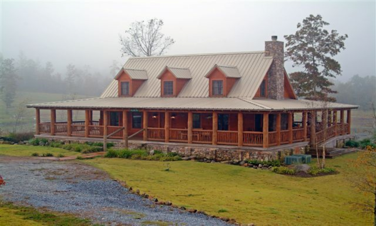 Log cabin with wrap around porch house with glass log for Single level home with wrap around porch