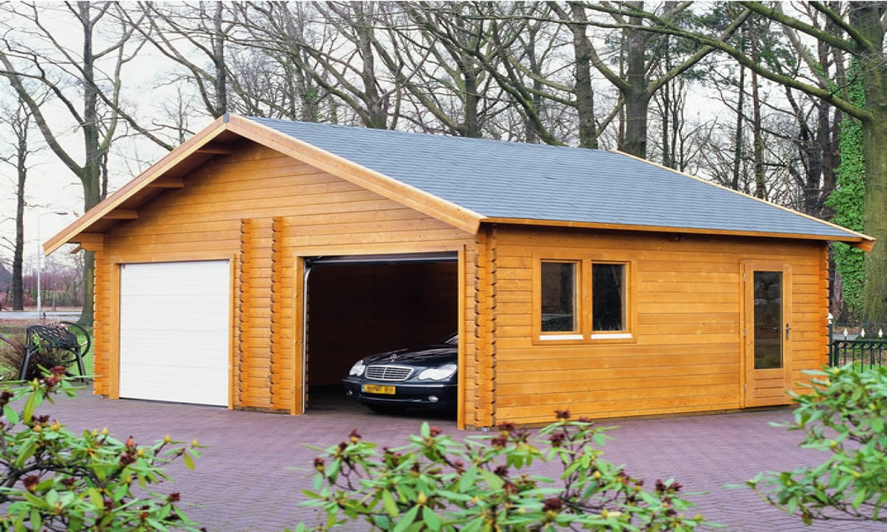 Log cabin garage kits prefab garage kits wood log garages for Log home garage kits