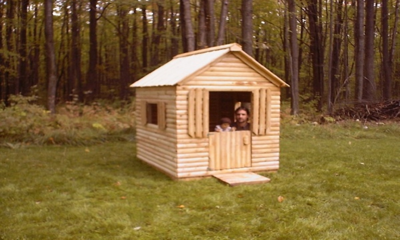 Log cabin playhouse with swing log cabin kids playhouse for Fishing cabin plans
