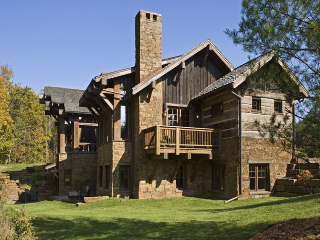 Rustic exterior home designs home exterior with stone for Stone exterior design