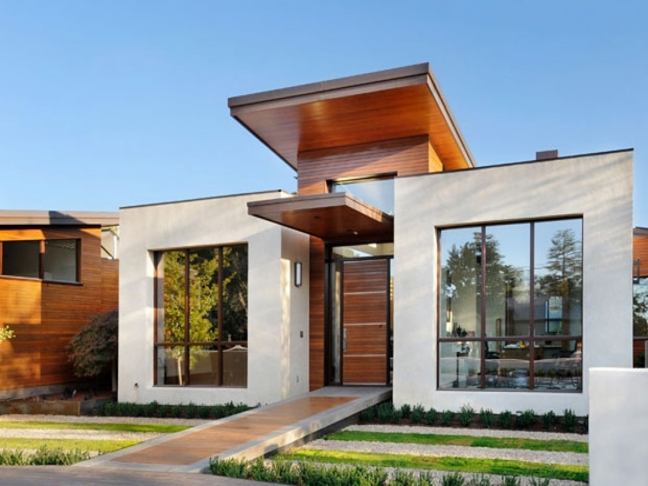 Small modern house exterior design small modern homes for Small house exterior