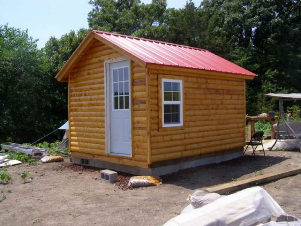Build small log cabin kits small log cabin homes plans for Log cabin builder