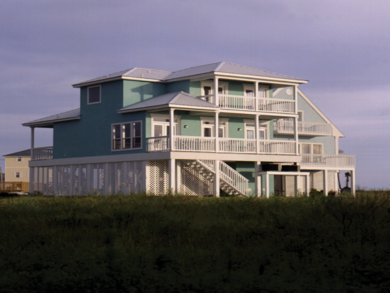 Beach style house designs home plans raised beach house for Ranch style beach house