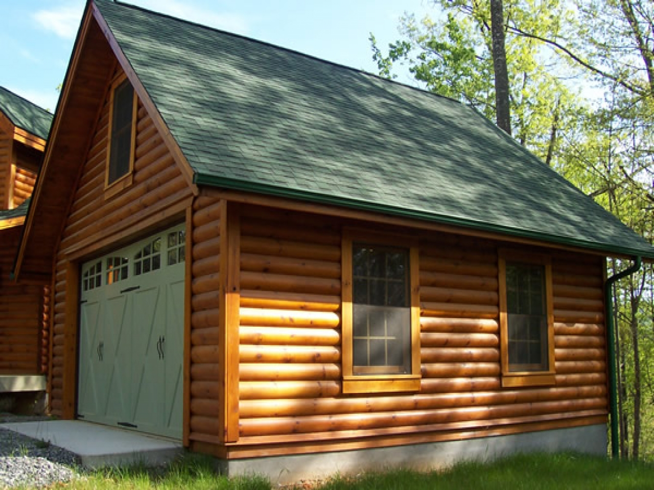 Log cabin garages 2 car log garage with apartment log for Cabin garage plans