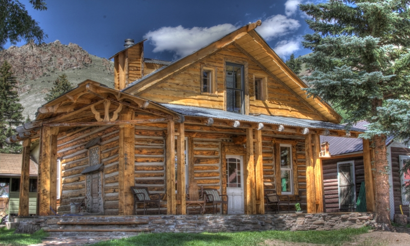 Cozy little log cabin affordable log cabin packages cozy for Cottage packages manitoba